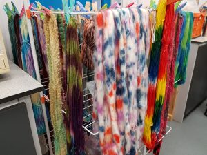A selection of yarns hand dyed wih procion dyes from DT Craft & Design by students on Debbie Tomkies' hand-dyeing summer school class