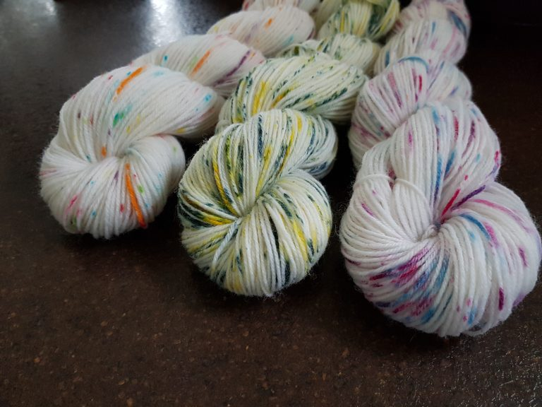 set of 3 hand-dyed yarns using speckling techniques