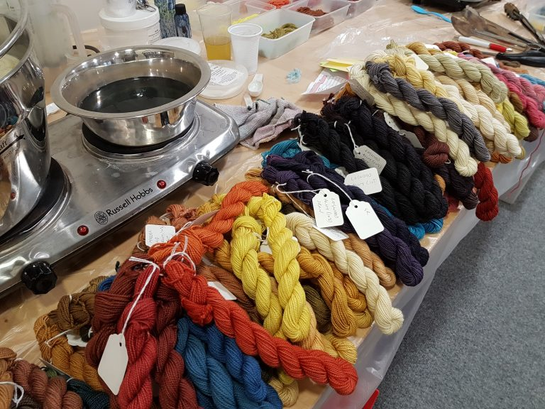 DT Craft and design - image from a natural dyeing workshop showing naturally dyed skeins and dyeing in progress